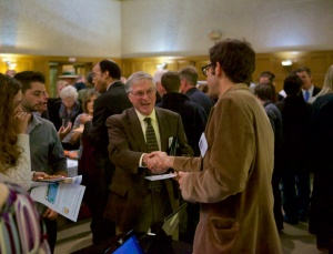 """Candidate Terry Tornek greets DPNA board member Wesley Reutimann, who explained the """"Complete Streets"""" exhibit."""