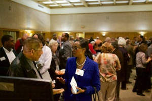 """Candidate Jacque Robinson chats with attendees and exhibitors during the DPNA's """"Downtown Expo"""" that preceded the forum."""